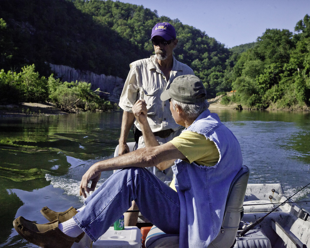 Two anglers on a fishing boat