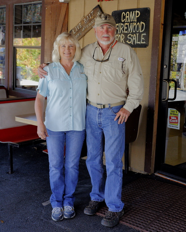 Wild Bill & Joanne Scruggs outside the Outfitter store