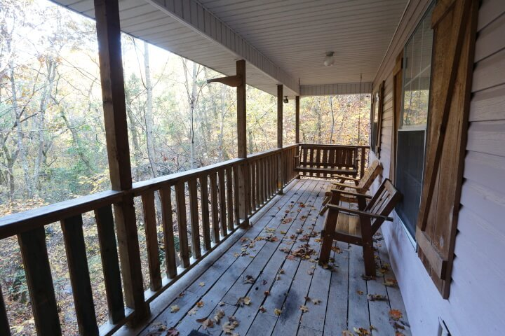 Porch area with benches and porch swing
