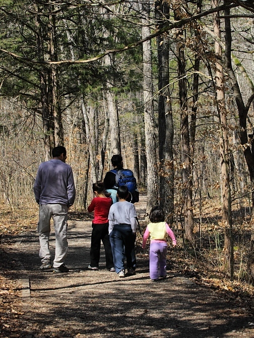 Family hiking together on a trail